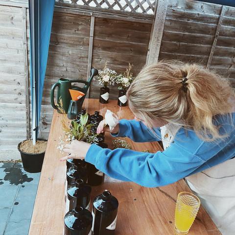 Caiti preparing wedding jars