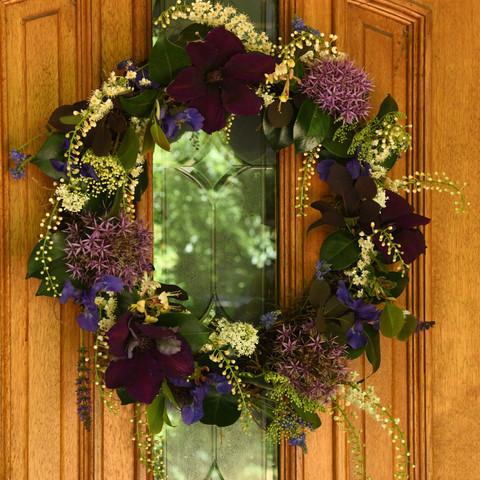 Clematis jackmanii purpurea, veronica, honeysuckle, Portuguese laurel, alliums, irises,