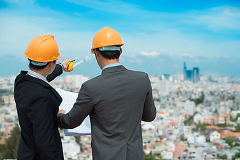 Businessmen in hardhats taking a look at