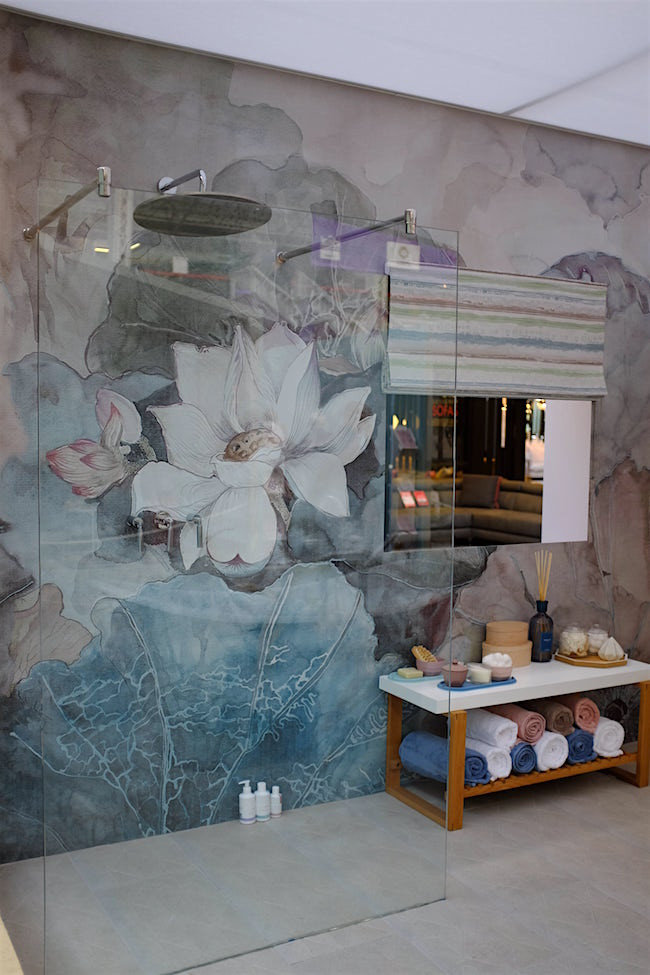 Bathroom with a floral mural wall