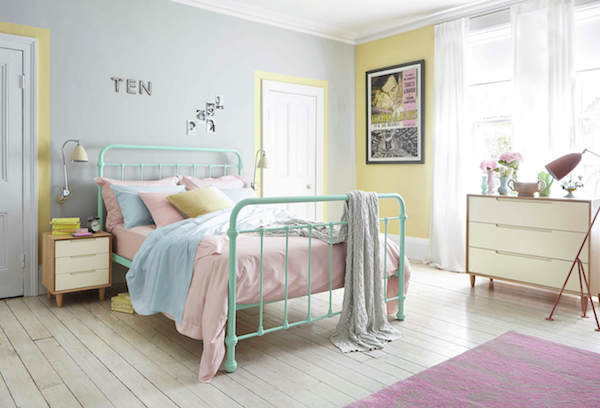 Pastel metal feather and black bed