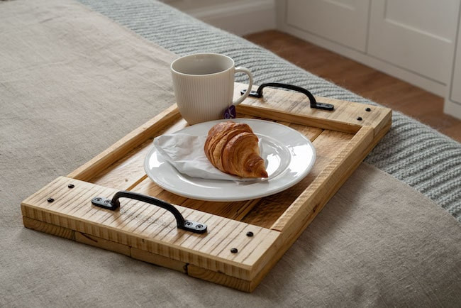 Wooden serving tray with breakfast