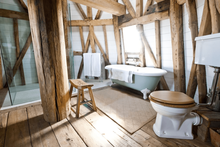 country style bathroom with wooden beams