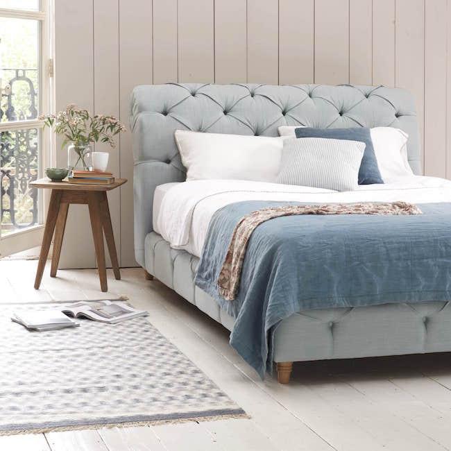 Blue velvet upholstered bed