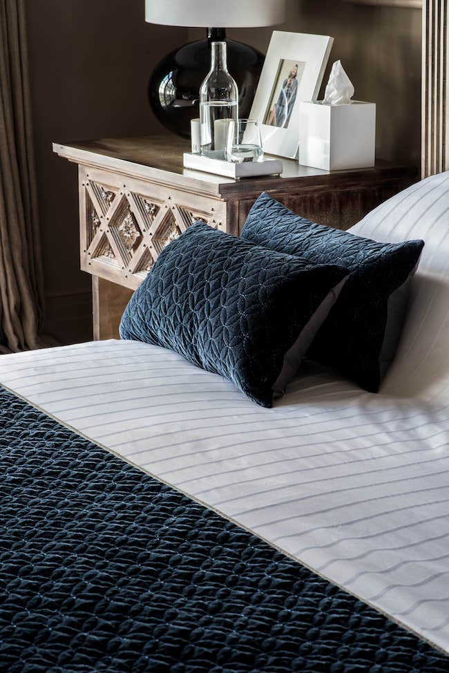 Velvet bedspread and cushions by Kelly Hoppen