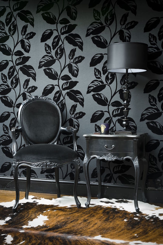 Black wallpaper and furniture