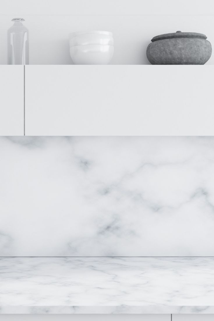 White kitchen with marble worktop