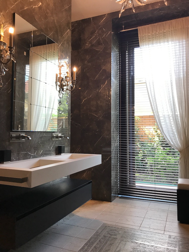 Dark marble bathroom walls