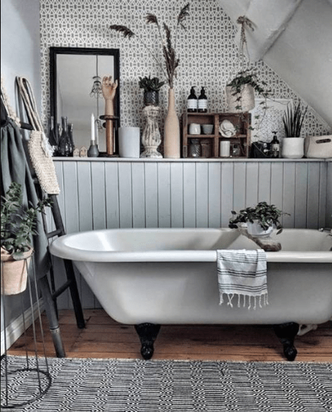 Roll top bath in country cottage bathroom