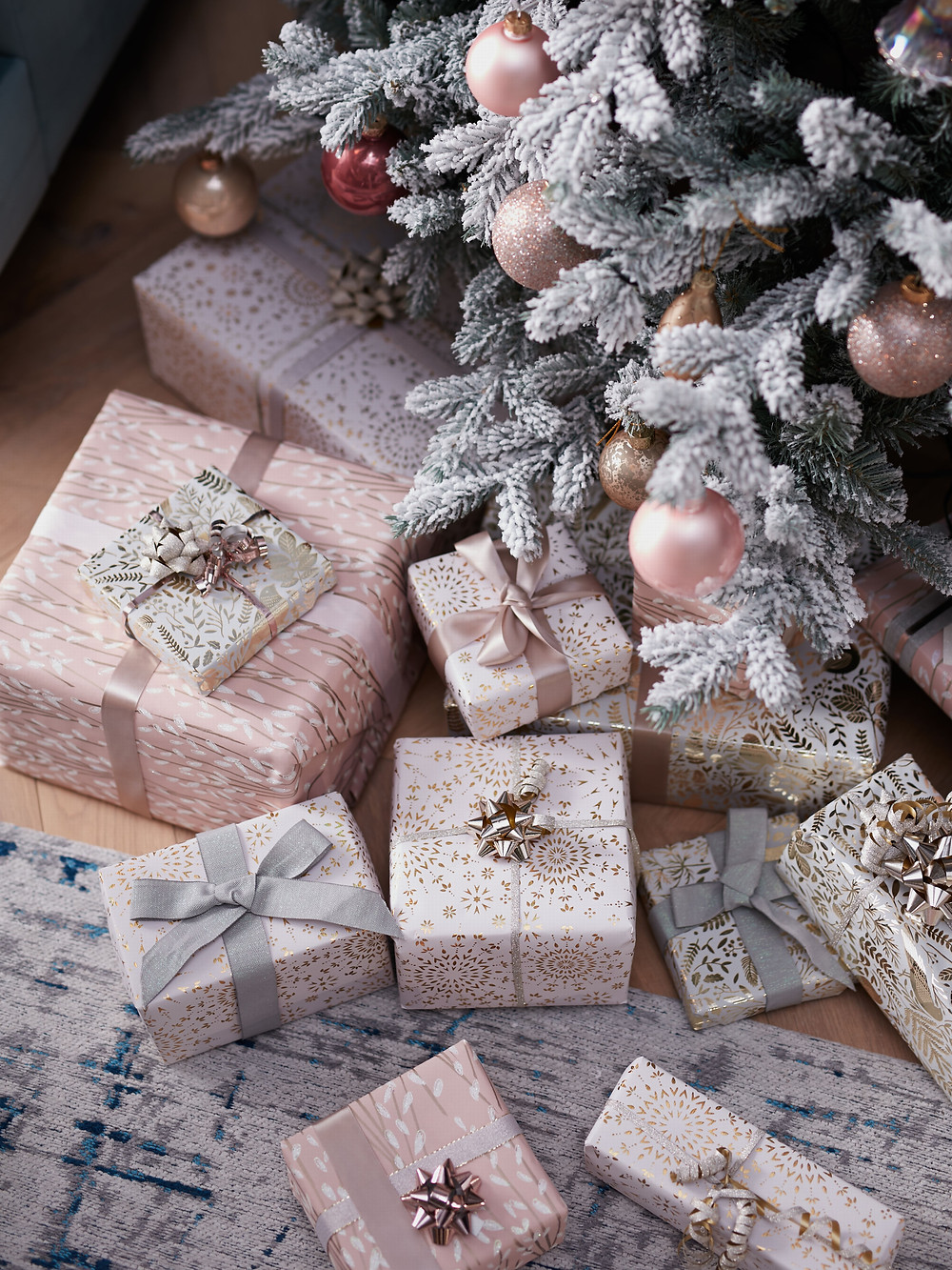 Pink Christmas presents under the Christmas tree