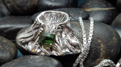yellow gold and silver helanite pend