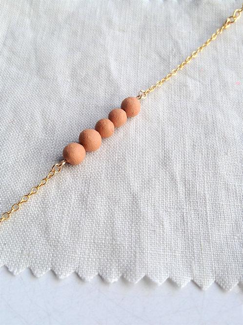 perles fines rondes orange argile