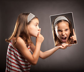little girl showing silence gesture and