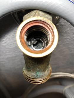 Piece of solder cause leak in washing machine valve