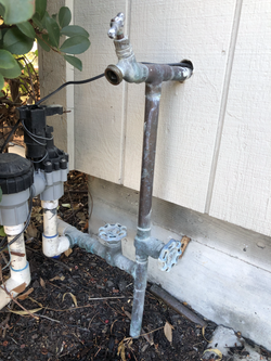 Two old gate valves on main water line