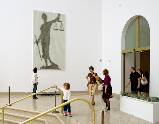 Shadow of Justice, 2007, wall installation with tea leaves, museum Narodowe, Poland, 350 x 200 cm