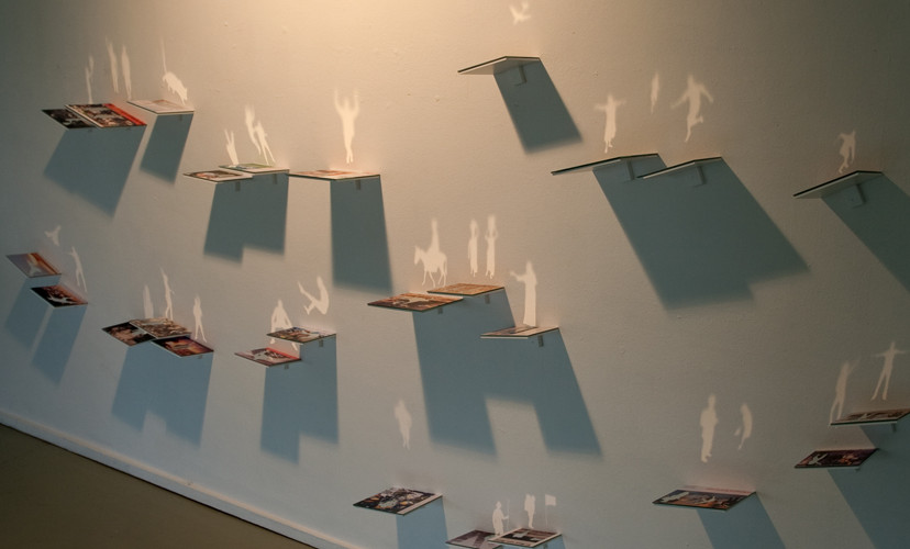 Release, 2010, images from magazines, newspapers, mirrors, light, variable dimensions