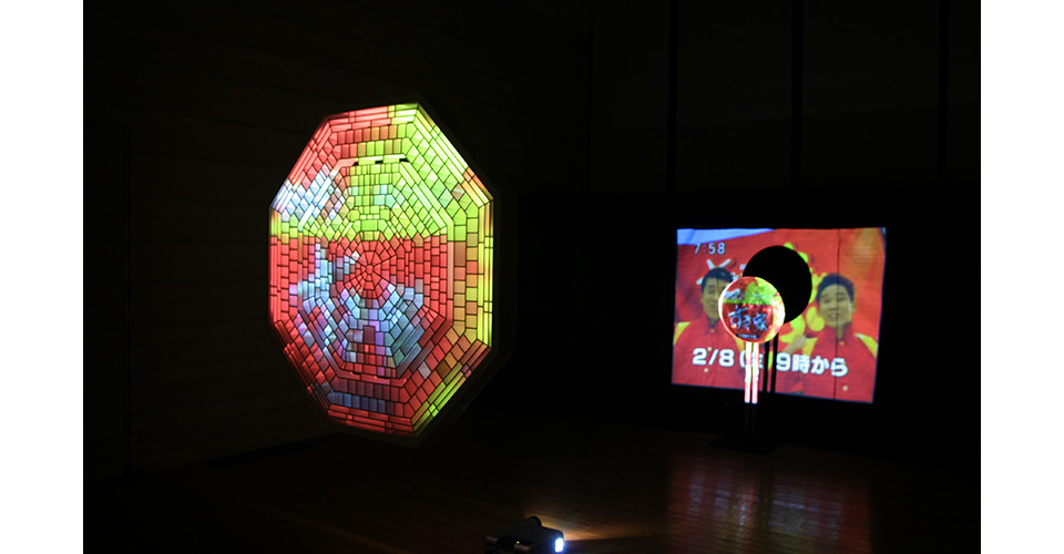 Active Anesthesia-the Reflection, 2008, video projector, Japanese TV commercials on DVD, powered subwoofer, hand-cut octagonal structure (diameter 115 cm), round mirror (diameter 46 cm), low frequency