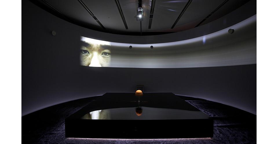 Active Anesthesia-the Attitude of Cranial Revolution, 2008, 610 cm diameter cylinder room, DVD, video projector, subwoofer, two motors, black mirror, human cranium, mirror, mixed media,  610  x 300 cm