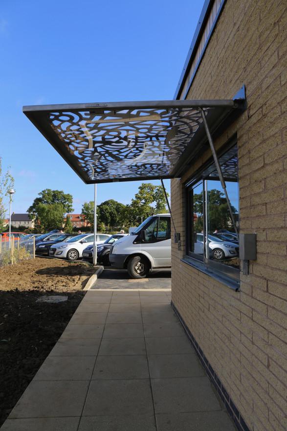Window kiosk canopy