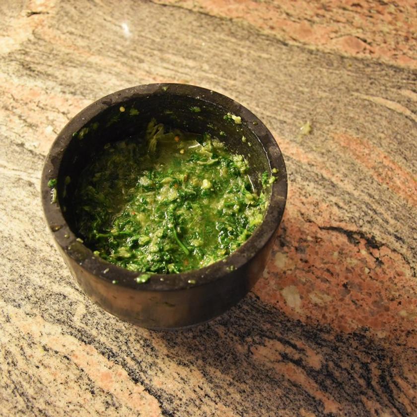 Chimichurri sauce made using pestle and mortar