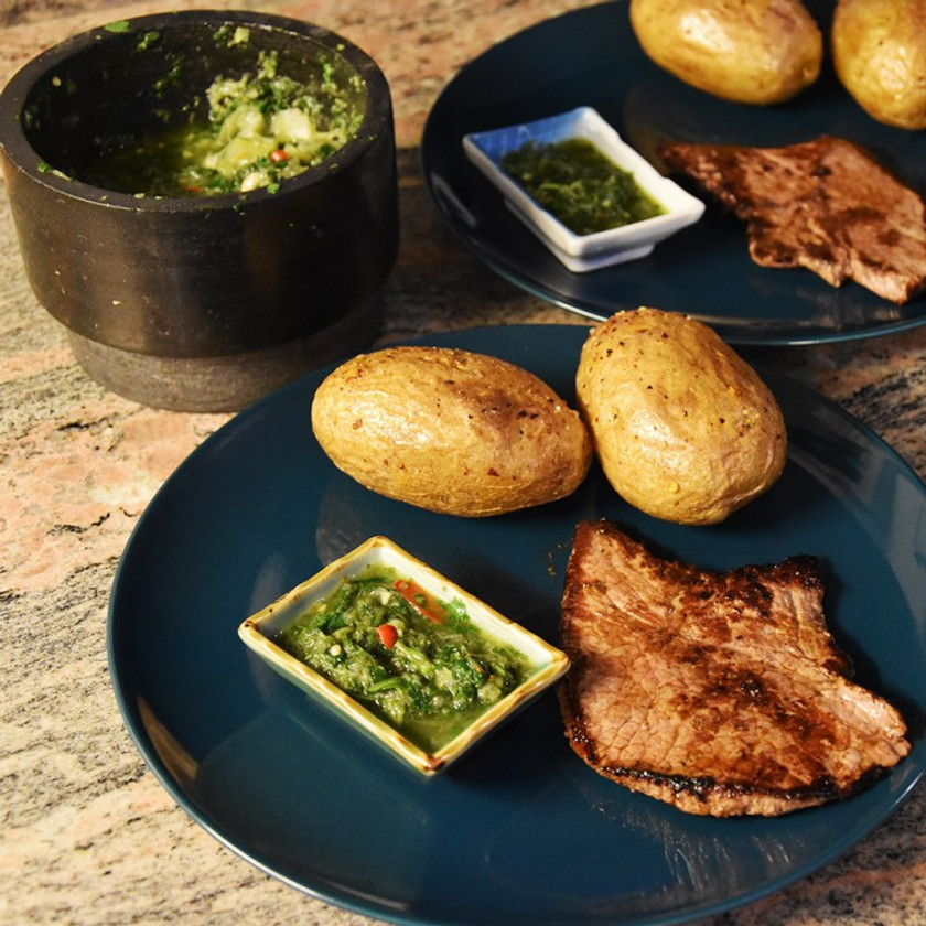 Chimichurri sauce for a steak and baked potatoes.