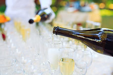 bartender-pouring-champagne-into-glasses