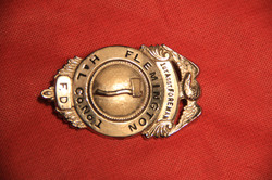 H & L badge