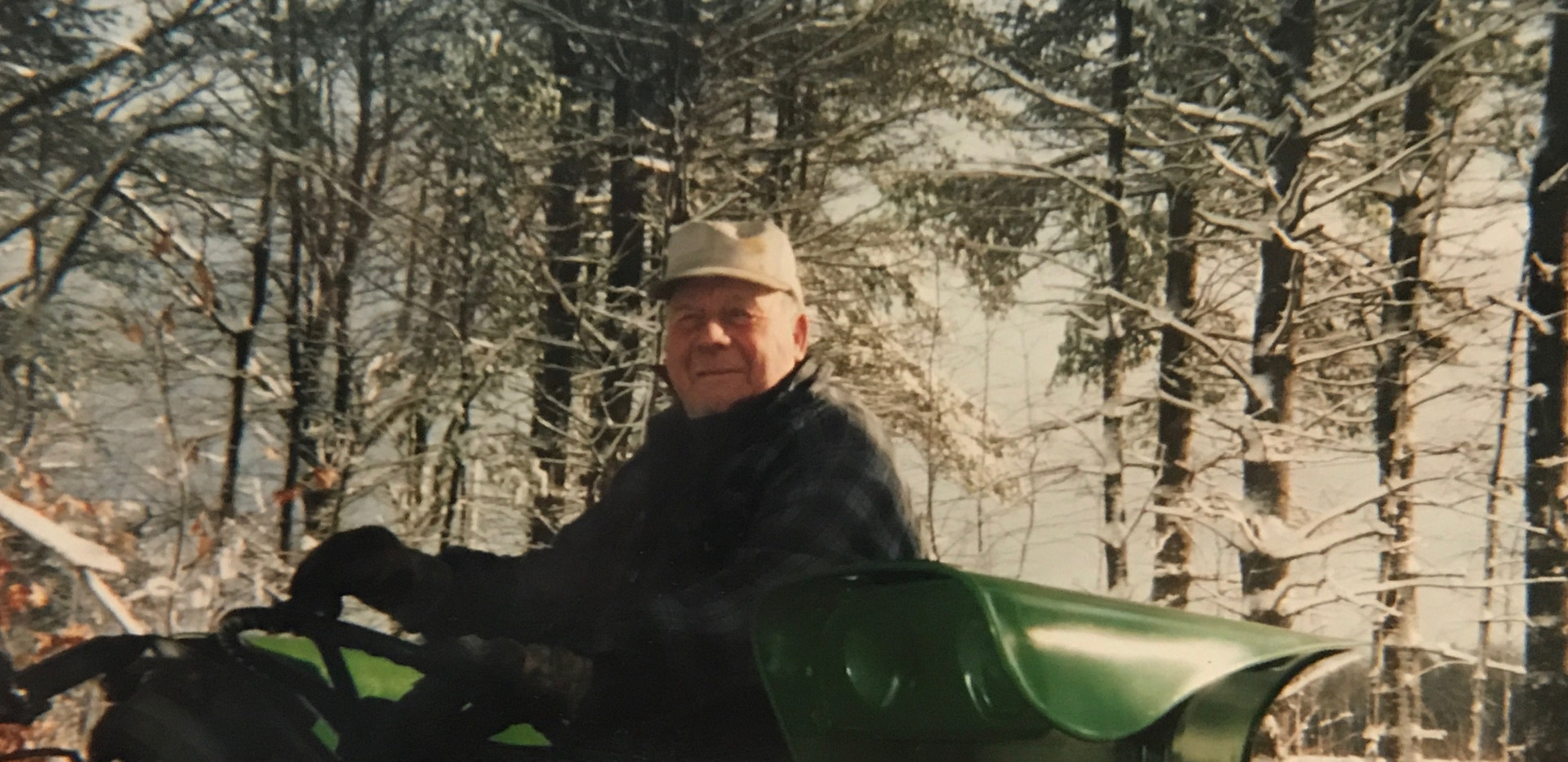 Farmer Othro (Tom) Sawyer atop his John Deere tractor