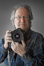 Dale portrait with camera.jpg