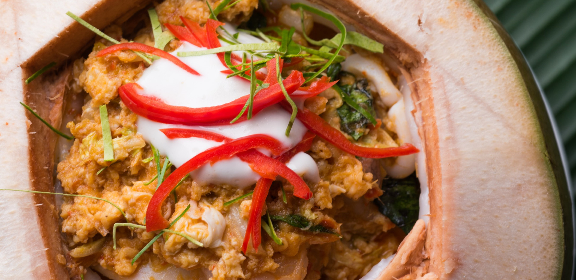 Steamed curry seafood in coconut cup