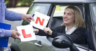 In this picure there is a Learner and a Novice Plate. A girl in a car, Mini, Driving school, Licance