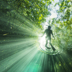 Freediver breathe up at surface