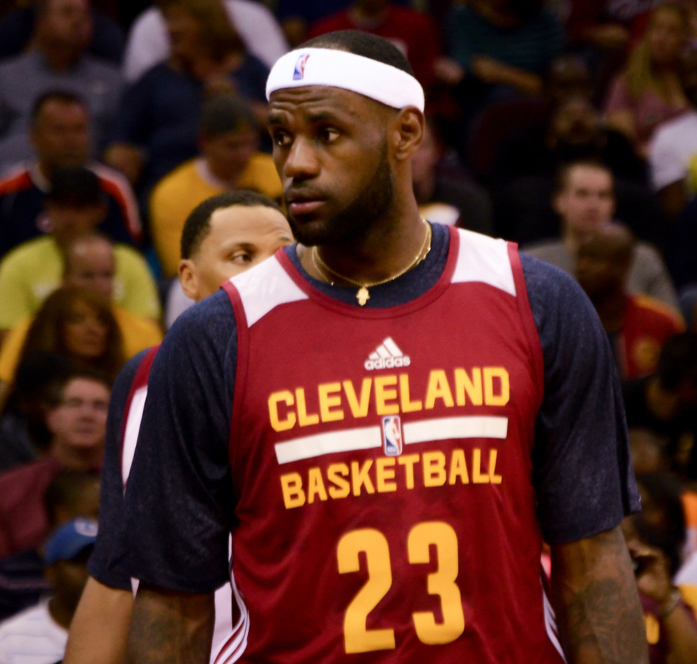 LeBron James wears a red Cleveland shirt and a headband during a game