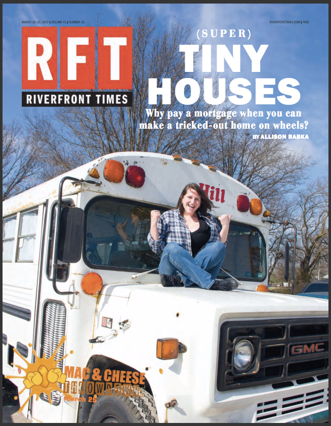 A woman sits on the front of a bus on the March 15 issue of the Riverfront Times