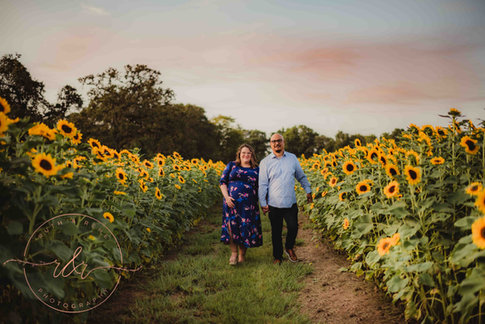 Men and Woman In A Sunflower Field