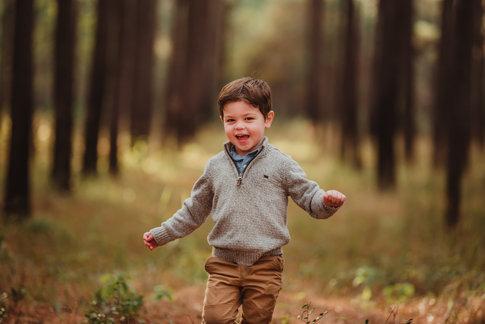 Boy Running Through Trees