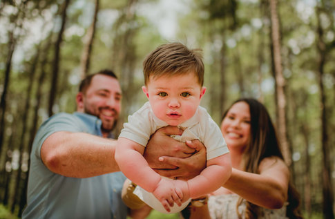 Couple Holding A Baby Boy