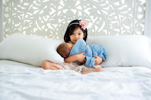 Young Child and Newborn Baby