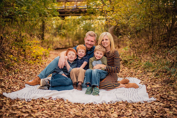 Young family posing for family portrait outdoors