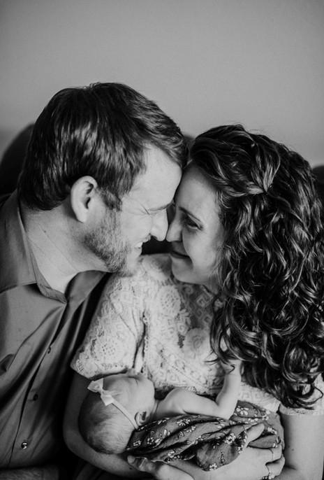 Woman and Man Holding Newborn Baby