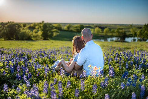 Couple Sitting in Flowers