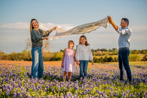 Family In A Flower Field