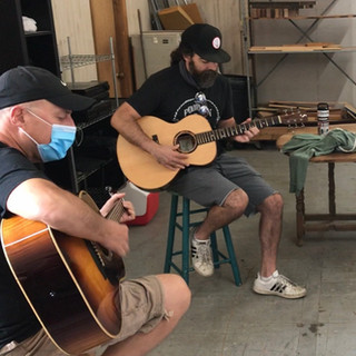 George, J, and John and a circle of Shimala guitars