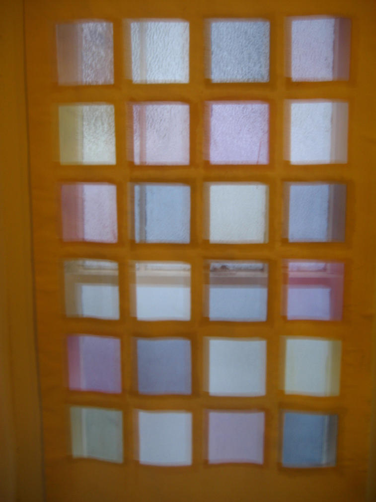 Windowpanes of naturally-dyed silk organza on duck cloth frame, midday light
