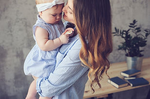 happy mother and baby playing at home in