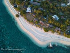夕暮れ時のビーチ バリカサグ島、フィリピン