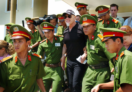 Gary Glitter leaves court in Vung Tau, Vietnam after being found guilty
