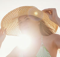 Young Woman in Sun Hat on Beach