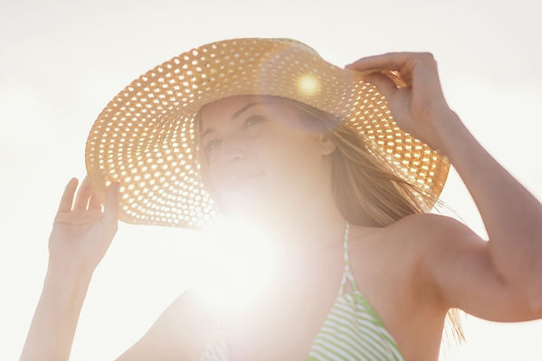 Young-woman-in-sun-hat-on-beach,-Jupiter